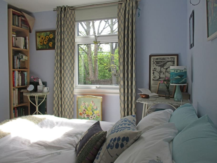 Bright and light bedroom overlooking garden and trees