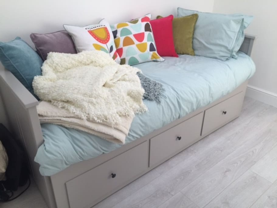 Very comfortable IKEA day bed, pulls out into King Size if preferred
