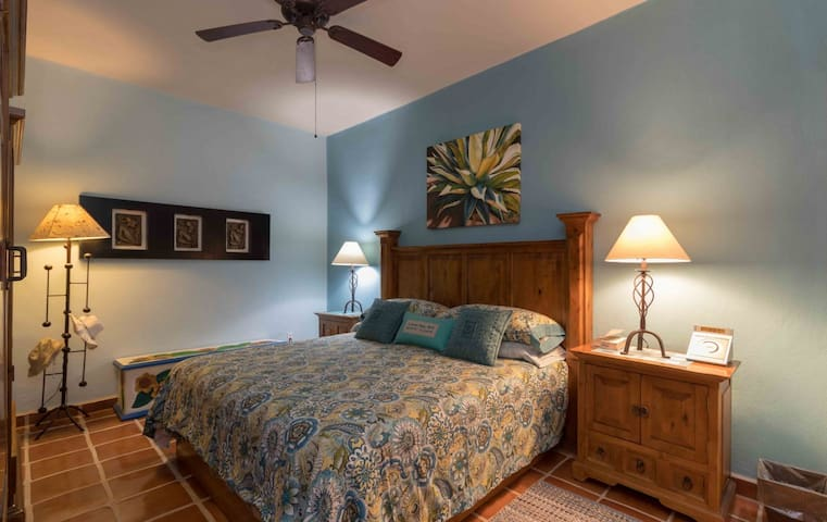 First floor master bedroom is serene and inviting with king bed, nice linens, and two large armoires for plenty of storage.