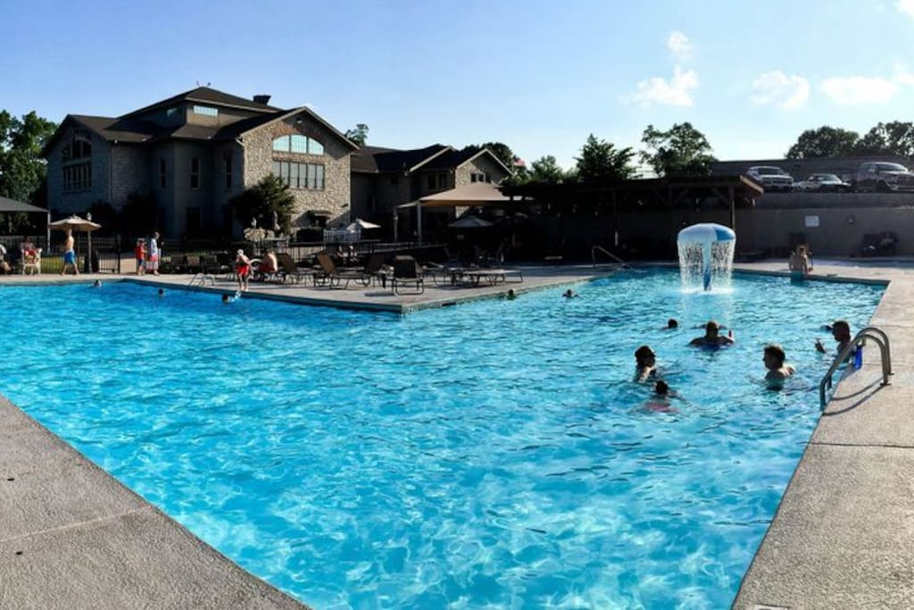 Amazing outdoor pool area with child's play are during summer months