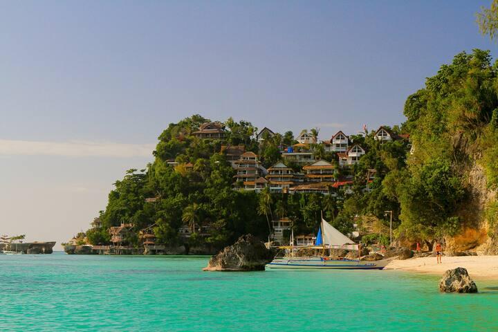 Diniwid Beach with Tropican ocean Villas and Apartment Facade