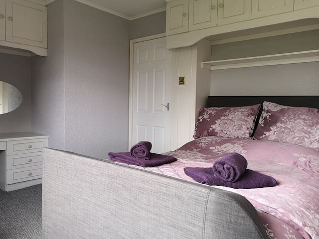 Master bedroom with ensuite shower room Double bed Two bedside cabinets Dressing table One double wardrobe