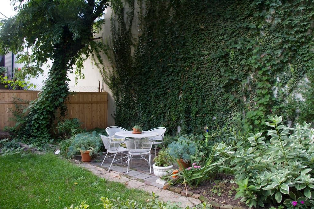 Beautiful private garden with ivy wall. Perfect for enjoying your morning coffee or a glass of wine.