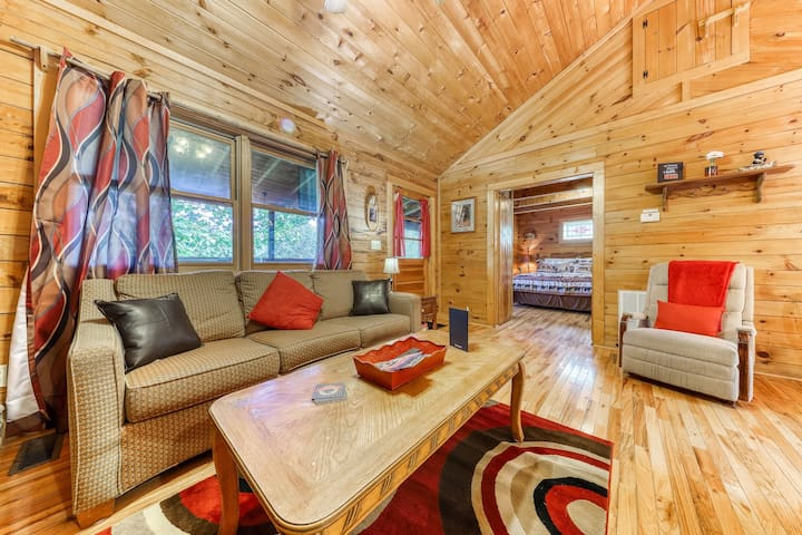 Charming cabin with private hot tub, patio, firepit & foosball - dogs OK!