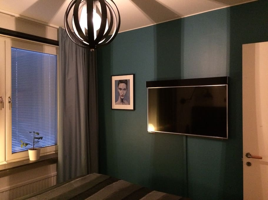 Master bedroom with a flat screen TV.