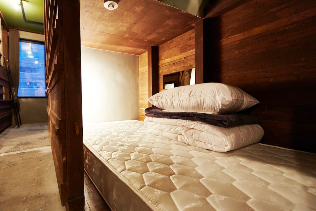 Inside of bed. All Beds are thick and comfortable. and have a light and socket.