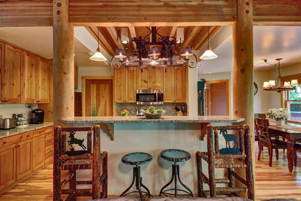 Kitchen is part of the great room perfect for entertaining with a walk out deck that wraps around the cabin