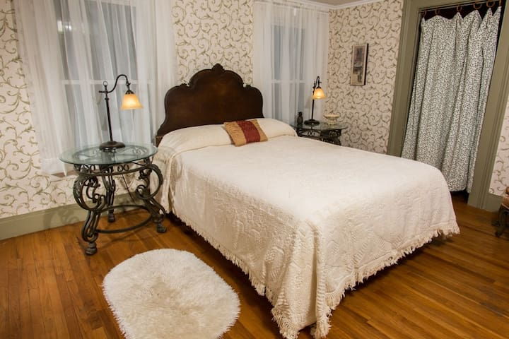 This is Room #3 which  is on the second floor, has a queen bed, and shares a bathroom.
