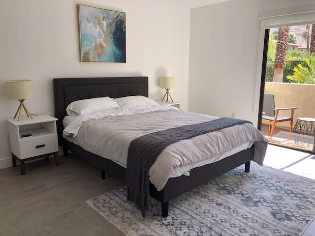 2nd bedroom with queen bed, leading to private patio with views of San Jacinto mountains