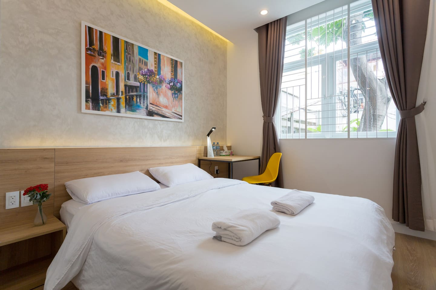 Your room with natural light, working desk, wardrobe, private bathroom and clean beddings and towels