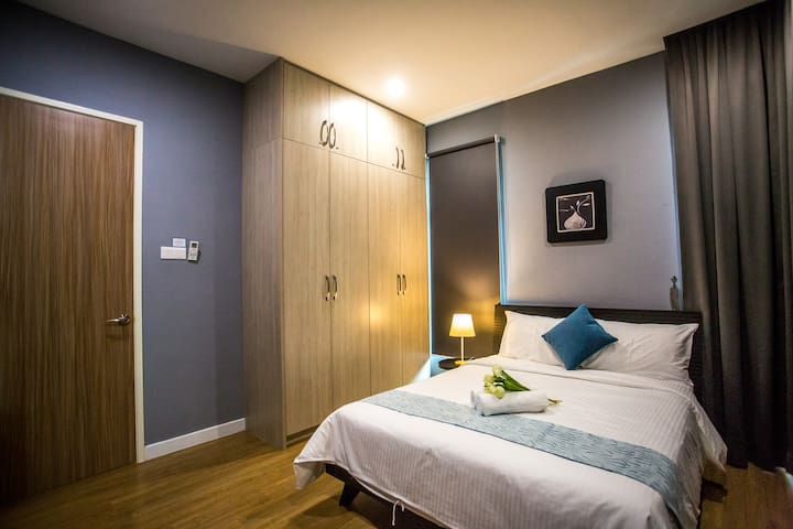 2nd Floor Airconditioned Bedroom 2  with Queen Size Bed , Wardrobe & Beside table Lamp
