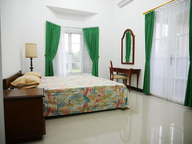 Master bedroom (2nd floor) with access to balcony.  You can see the Mount Merapi from your window when you wake up each morning. This room is air-conditioned.