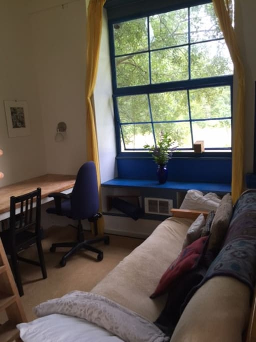desk and futon sofa
