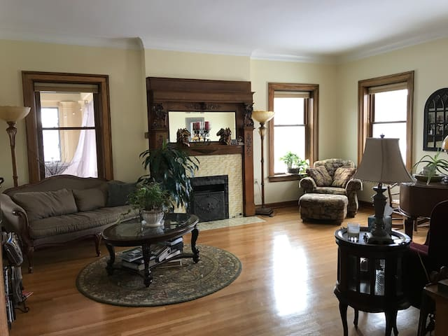 living room with a gas fireplace and a baby grand piano for your relaxing enjoyment