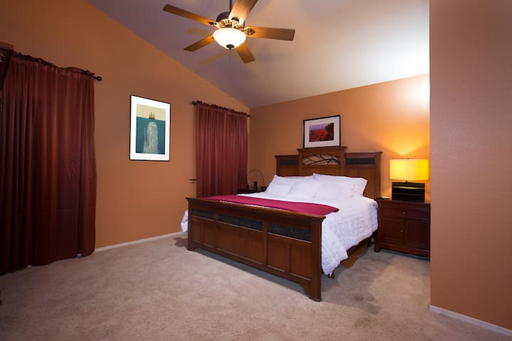 Master bedoom with california king, sleep number bed..Ensuite master bath, with private access to hot tub and double headed shower.