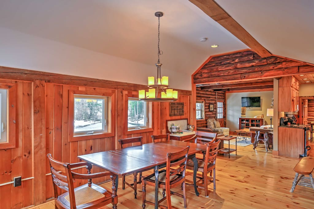 The rustic cabin boasts 1,100 square feet of comfortable living space with beautiful redwood and log woodwork decor.