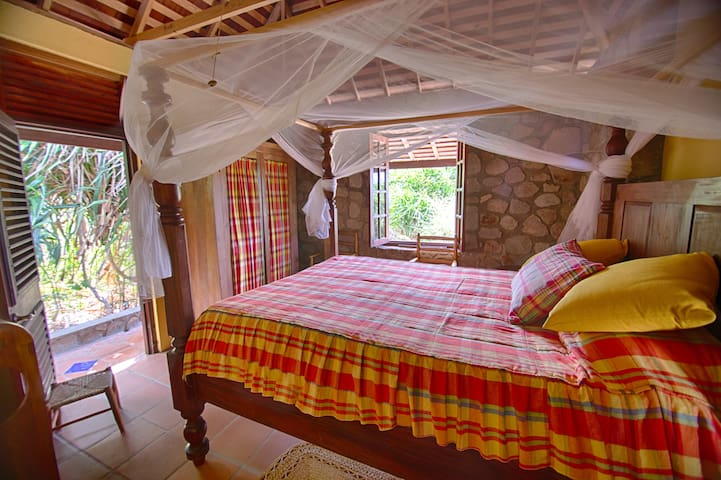 A private bedroom on the first floor provides a quiet setting for the guests.