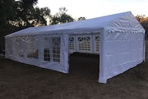 This is a 10 m x 5 m marquee. The sides can be on or off, or partially opened, to suit your needs, and the changing nature of weather.