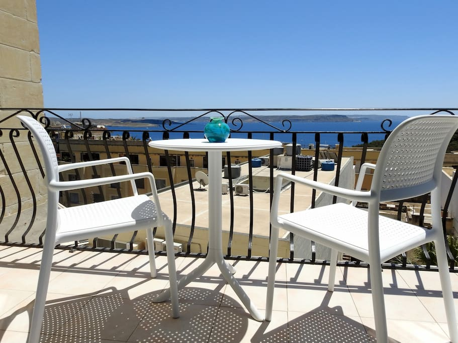 The private front balcony is large 12x4 foot (3.7x1.2m), has outdoor chairs, table, parasol.