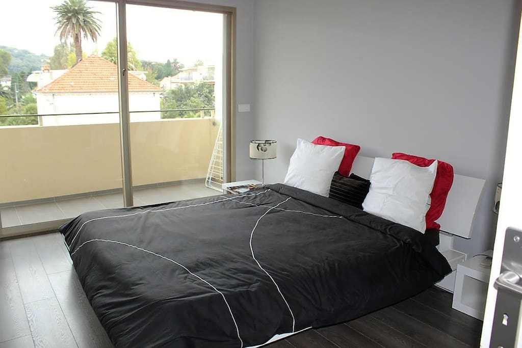 Spacious double bedroom with the AC and access on the terrace  (view on the swimming pool)