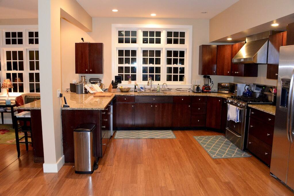 Large, open kitchen and high end appliances stand ready to make meals  for large or small groups