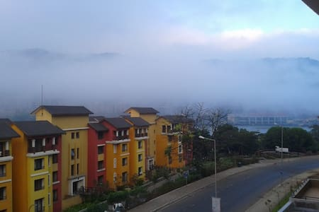Spacious Studio Apartment  with a scenic lake view - Lavasa