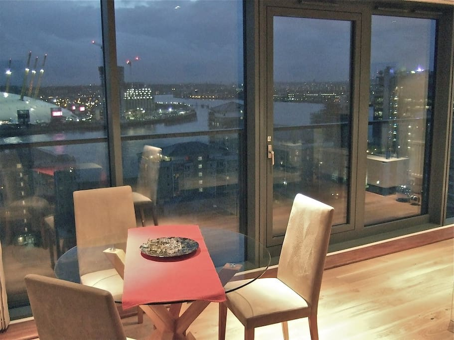 Living room with balcony and views over river Thames