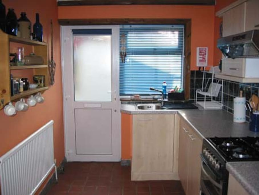 Kitchen with Gas oven, Microwave & washing m/c