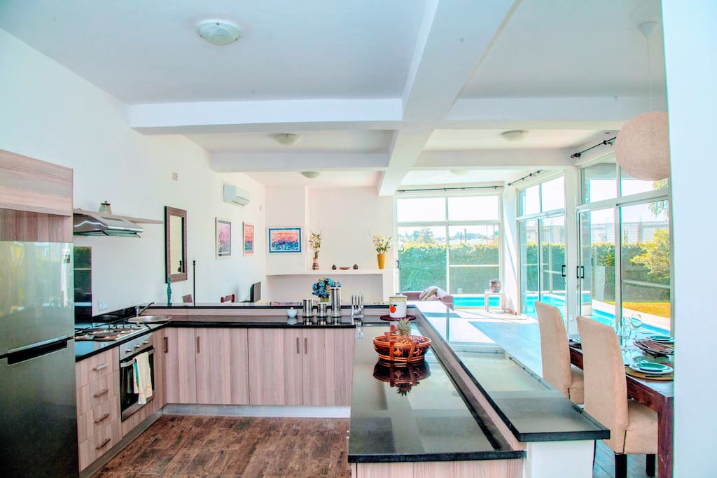 Open plan kitchen and scullery: Dishwasher and washing machine