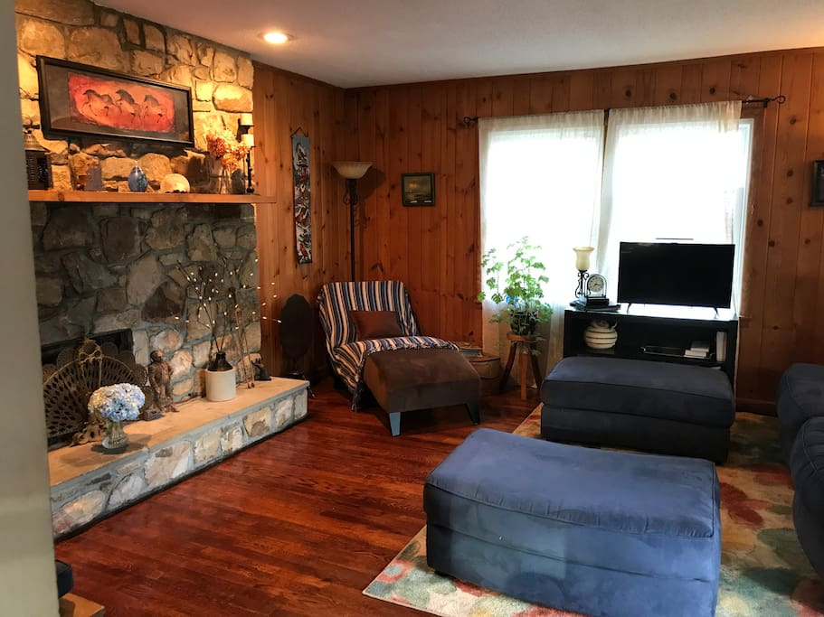 The large living room has a fireplace (gas hooked up in fall/winter) and plenty of seating options!