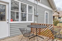 Back porch with seating for you to enjoy your morning coffee.