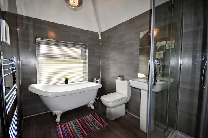 Bathroom With Separate Shower and Freestanding Slipper Bath