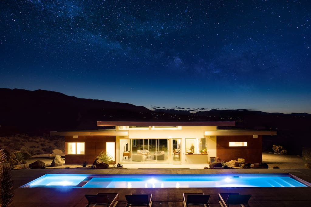 SkyHouse sits at the top of a hill, nested in the desert with night time views of the milky way.