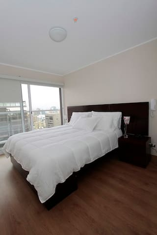 Queen Size Bed and safe in bedroom