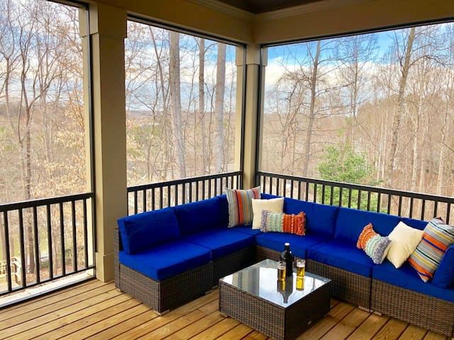 Enjoy a cold beverage on the covered porch and watch some tv (tv above couch outside).