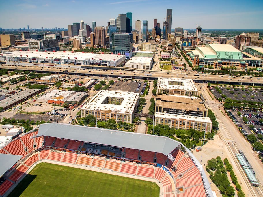 """This aerial view of East Downtown, or """"EaDo"""" as Houstonians refer to it, highlights the proximity of the major local attractions including BBVA Compass/Dynamo Stadium, Minute Maid Field, George R. Brown Convention Center, the downtown hotels and central business district, and the Toyota Center.  The townhome is located three blocks south (to the left) of Dynamo Stadium, the soccer stadium in the foreground of the picture above."""