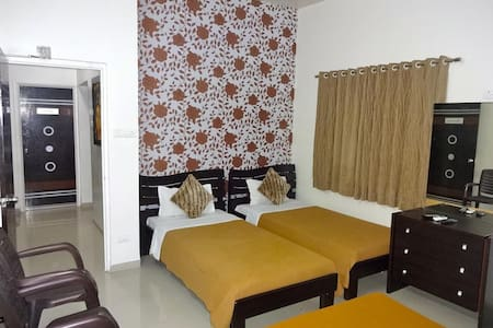 Furnished with a mixture of comfort, space and elegant decor, this room is a perfect choice for a family. Situated on the 1st floor of the villa this large room features a queen sized bed, two single beds and a large attached bathroom.