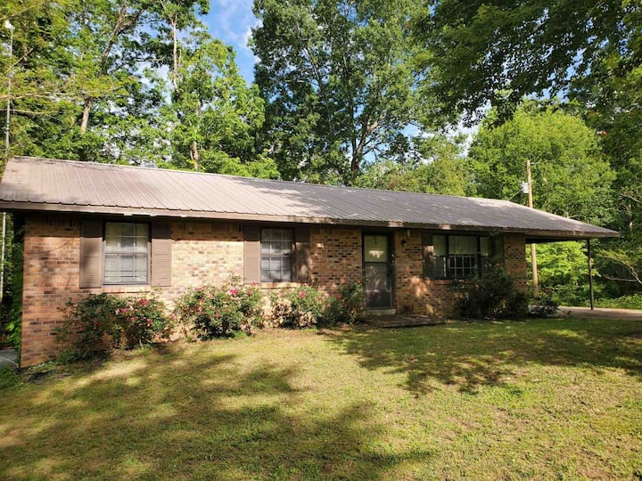 Set in the woods, right by the river, lovely home