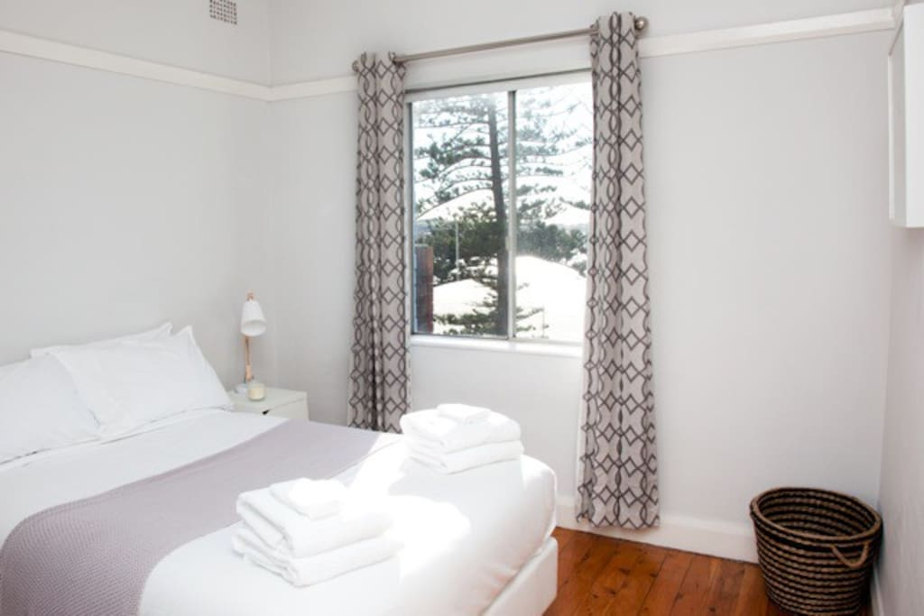 Second bedroom, with actual beach and sea views! Hear the waves while you drift off to sleep.