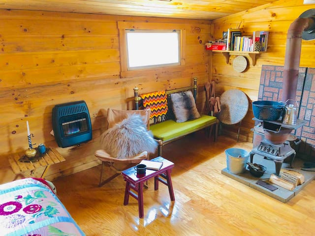 Cozy simplicity. Blue flame propane, cook stove to cozy up with a book or friendly game.