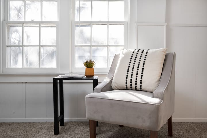 Sitting area to put on your shoes or read a book in the master suite upstairs.