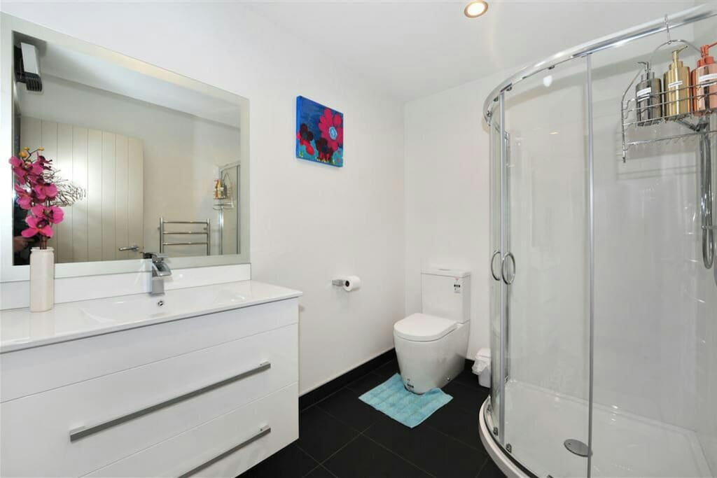 Bathroom 2-with shower, toilet, vanity,  heated towel rail and bathroom fan heater