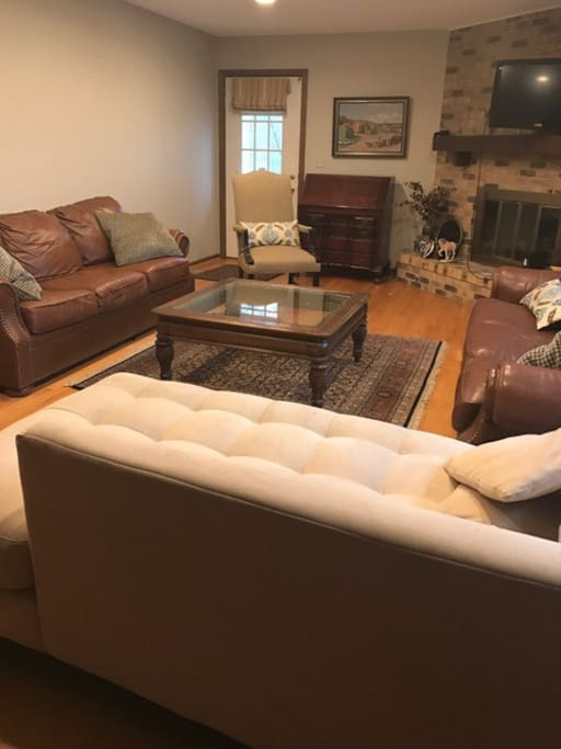"Great room with plenty of seating space. Sofas would accommodate 3 extra guests if needed. Additional guest fees applicable. Consider renting the optional 3rd bedroom listed as ""Northwest Suburbs Suite annex""."
