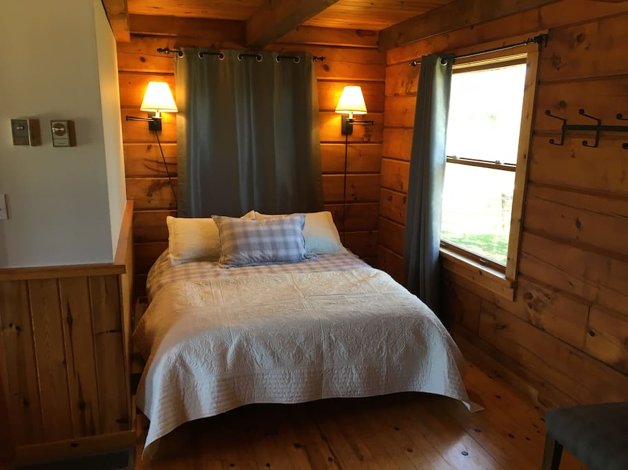 Queen bed in attached bunkie cabin, two additional twin beds in loft above this bed. Ensuite bathroom.