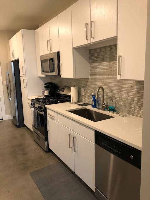 Kitchen with stainless steel appliances, Keurig, toaster, and essentials
