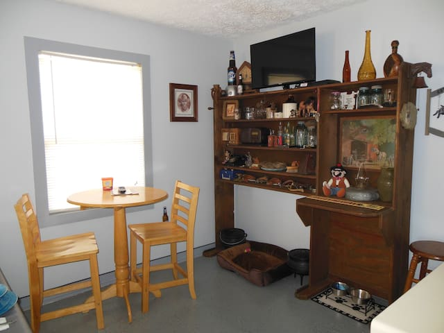 Small round top game table - We have various board games including checkers and chess.