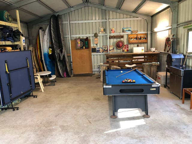 This is where our guests like to socialise and talk about the days events  and unwind.  Dart board, table tennis and pool table and red cups for beer pong available along with bar fridge for your drinks and UE Boom speaker to play your sweet tunes.