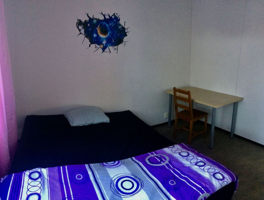 Room with both single bed adjusted as a double bed.