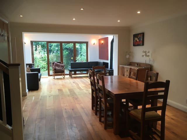 Open plan dining area, massive dining table to fit 10 people when extended.