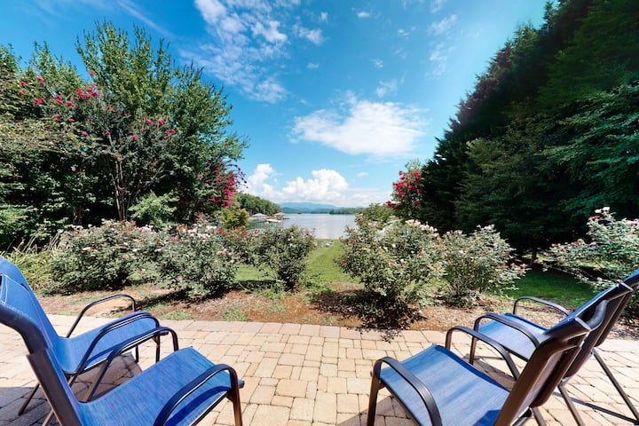 Stunning lakefront estate on one acre w/ a private dock, free WiFi, & more!